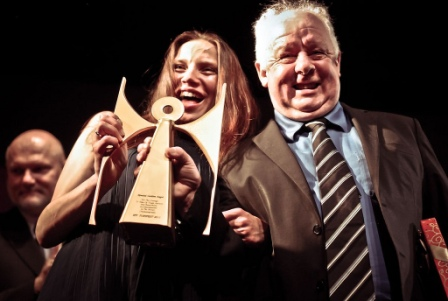 Tofifest director KafkaJaworska and Jim Sheridan with Tofifest Golden Angel Award